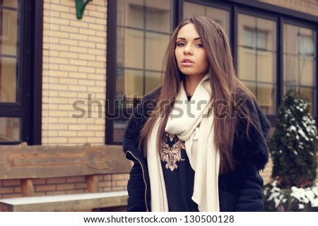 portrait of stylish young girl in black clothes