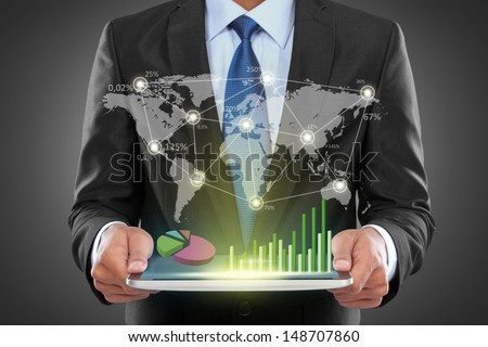 Portrait of success businessman with laptop showing social business connected - stock photo