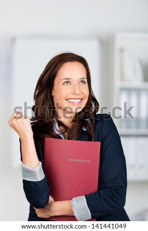 Portrait of successful applicant holding her document files