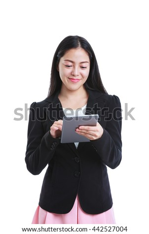 Portrait of successful asian business woman holding tablet computer isolated on white background, working on touching screen. Positive human emotion. Studio shot. - stock photo