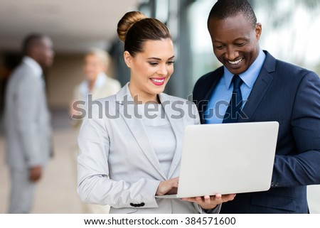 portrait of successful business executive using laptop computer - stock photo