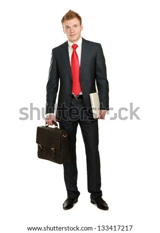 Portrait of successful business man with bag and laptop