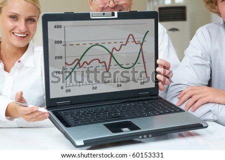 Portrait of successful business partners showing new computer project - stock photo