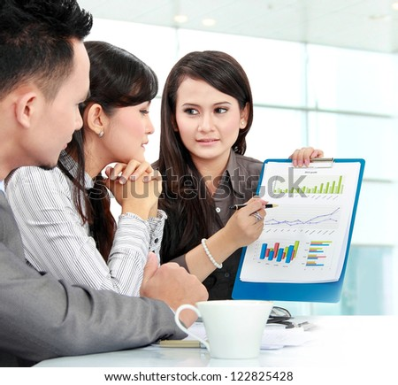 Portrait of successful business people discussing about company income - stock photo
