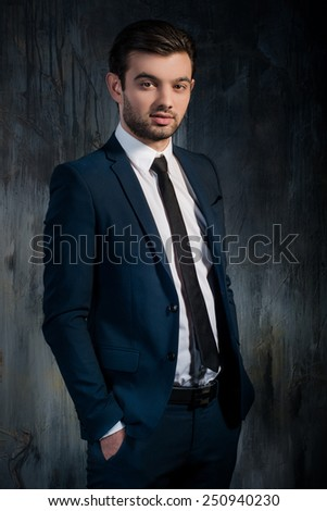 Portrait of successful businessman in blue suit