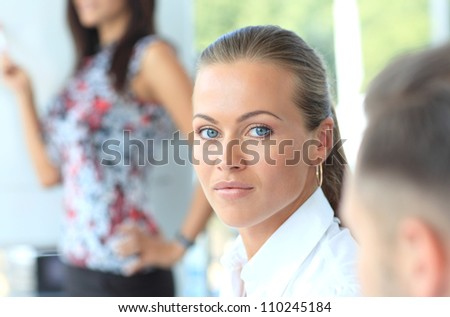 Portrait of successful businesswoman and business team at office meeting - stock photo