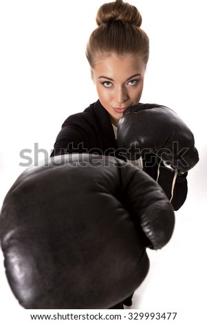 Portrait of successful businesswoman with boxing gloves on a white background