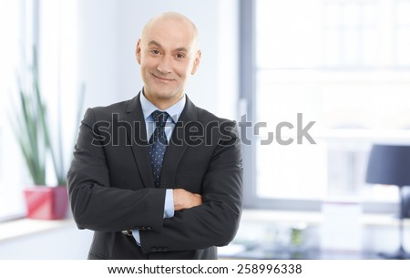 Portrait of successful chairman standing at office. Business people.  - stock photo