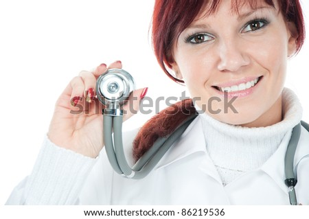 Portrait of successful cute young female doctor holding a stethoscope, white background - stock photo