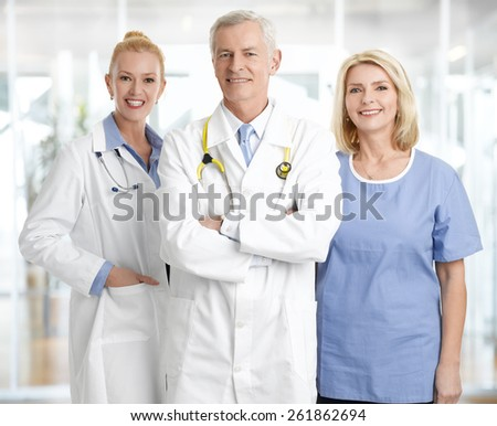 Portrait of successful medical staff standing at private clinic.  - stock photo