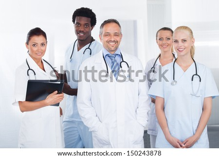 Portrait Of Successful Multiracial Doctors In Clinic