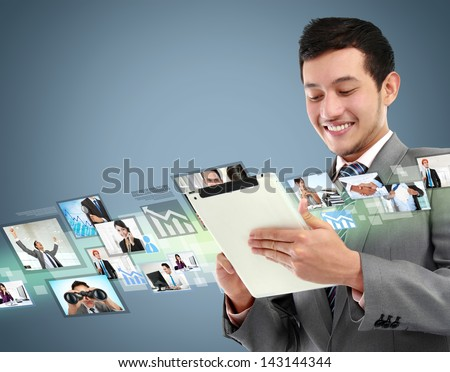 portrait of successful young business man with tablet in the office - stock photo