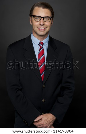 Portrait of successful young businessman isolated against gradient background