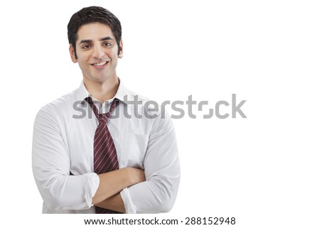Portrait of successful young businessman with arms crossed - stock photo