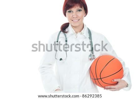 Portrait of successful young female doctor holding a basketball. Sports and healthy life-style concept - stock photo