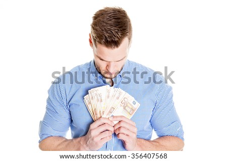 portrait of successful young man holding money dollar bills in hand, isolated on white background. Finacial concept - stock photo