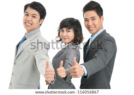 Portrait of successful young office workers with their thumbs up