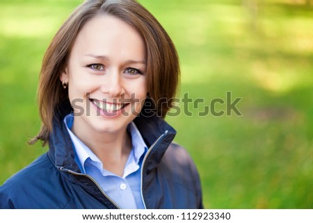 Portrait of successful young woman outdoors - stock photo
