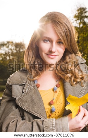 Portrait of sunny fall fashion woman in colorful clothes.
