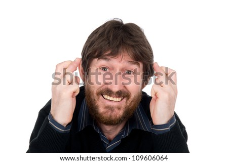 Portrait of superstitious male with fingers crossed - White background - stock photo