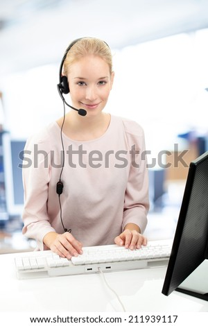 Portrait of support phone operator in headset working at office. Business people.