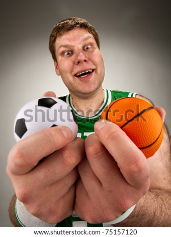 Portrait of surprised basketball player with two balls - stock photo