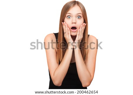 Portrait of surprised beautiful girl holding her head in amazement and open-mouthed. Over white background. Isolated - stock photo
