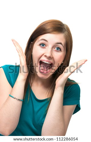 Portrait of surprised beautiful girl in casual wear - stock photo