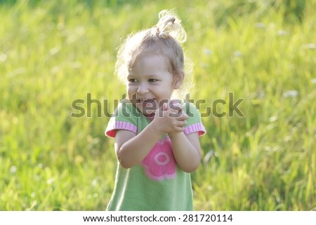 Portrait of surprised laughing two years old preschooler girl with flinging arms - stock photo