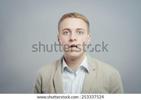 portrait of surprised man - stock photo