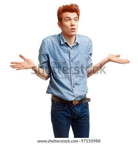Portrait of surprised red haired young man in casual clothes standing over white background.