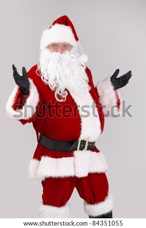 Portrait of surprised Santa Claus, looking at camera, isolated on gray background.? - stock photo