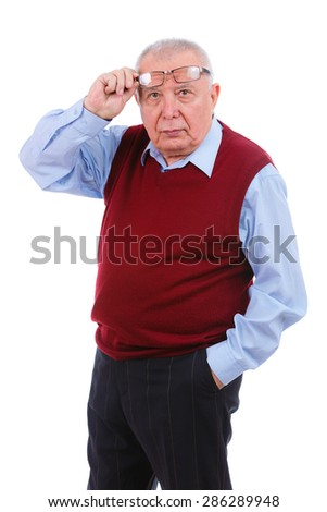 Portrait of surprised senior elderly teacher man with glasses, wearing cardigan marsala color and blue shirt, isolated on white background. Human emotions and facial expressions. Education concept - stock photo