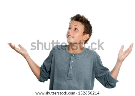 Portrait of surprised teen boy with arms open. Isolated on white background.