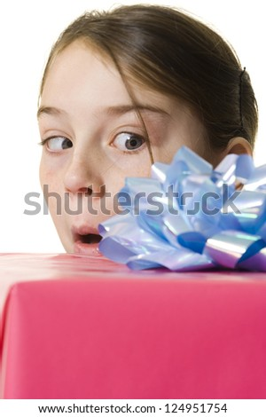 Portrait of surprised young girl looking at present