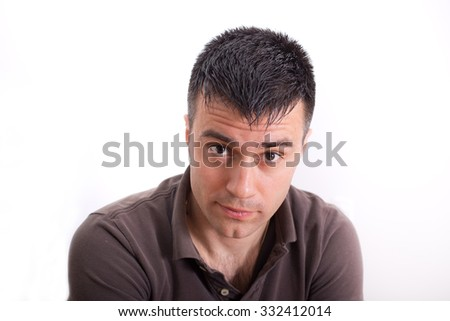 Portrait of surprised young man staring at camera. Isolated on white background - stock photo