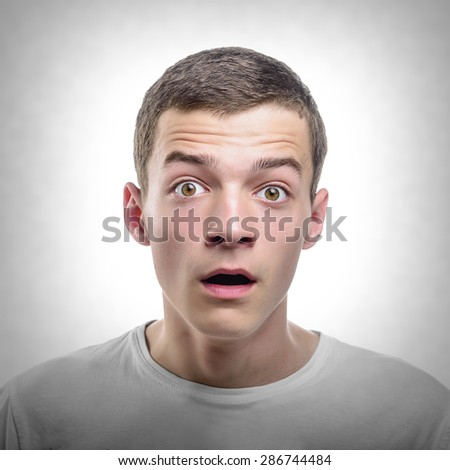 Portrait of Surprised Young Man. Toned photo. - stock photo