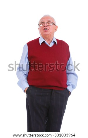 Portrait of swears senior old teacher man with glasses, holds hands in pockets, cardigan marsala color and shirt, isolated on white background. Human emotions, facial expressions. Education concept