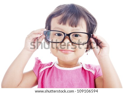 Portrait of sweet asian preschooler wearing glasses. shot in studio isolated on white