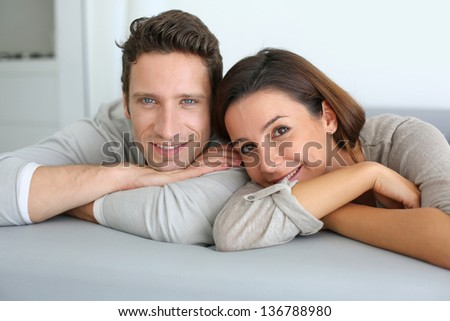 Portrait of sweet couple sitting in sofa