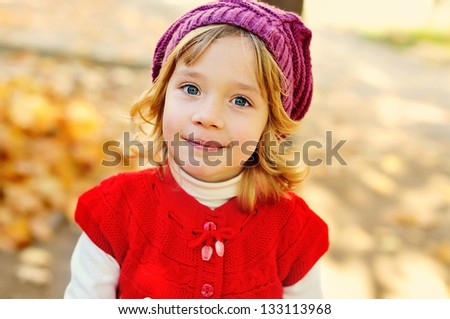 portrait of sweet girl in fall time - stock photo