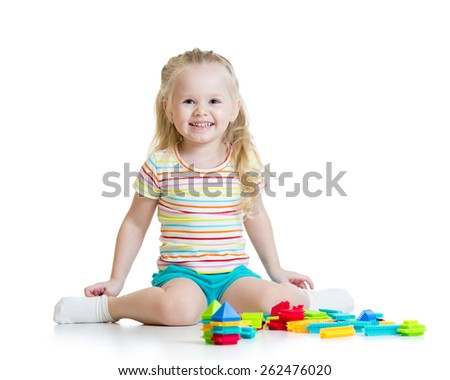 Portrait of sweet kid little girl with toy blocks