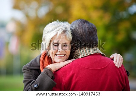 Portrait of sweet mature couple embracing each other in the park