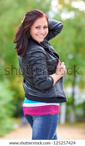 Portrait of sweet young woman enjoying at the park - Outdoor