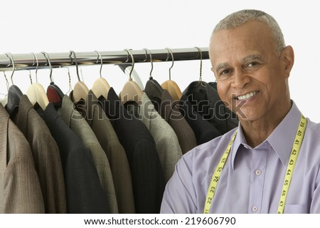 Portrait of tailor smiling - stock photo