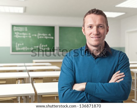 portrait of teacher crossed arms at school