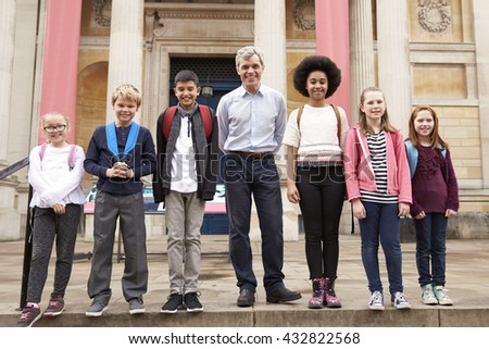 Portrait Of Teacher With Class Standing Outside Museum - stock photo
