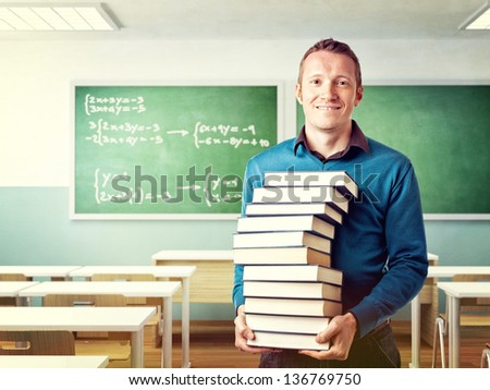 portrait of teacher with lotf of books - stock photo