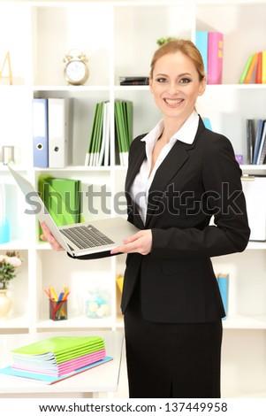 Portrait of teacher woman in classroom - stock photo