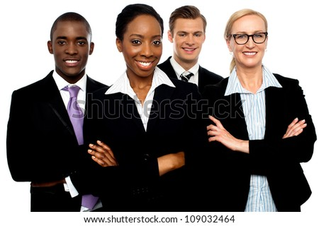 Portrait of team of business associates posing with arms crossed - stock photo
